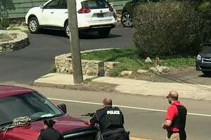 Police on the scene of an active shooter incident on Main Street in Branford Tuesday.