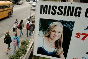 FILE: A 2006 photo shows a missing poster for student Kristin Smart in the California Central Coast town of Arroyo Grande. Smartwas in her first year at Cal Poly when she vanished in 1996. Smart was declared legally dead in 2002, despite the fact that her body has never been recovered. The sign is on property belonging to the attorney for the Smart family.
