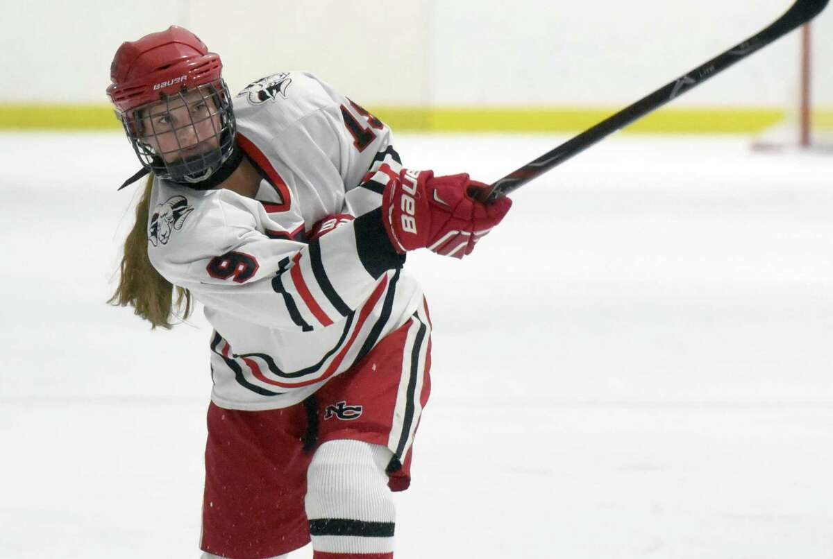 New Canaan's McKenna Harden (19) follows through on a shot during a girls ice hockey game against West Haven/SHA at the Darien Ice House on Jan. 20, 2020.