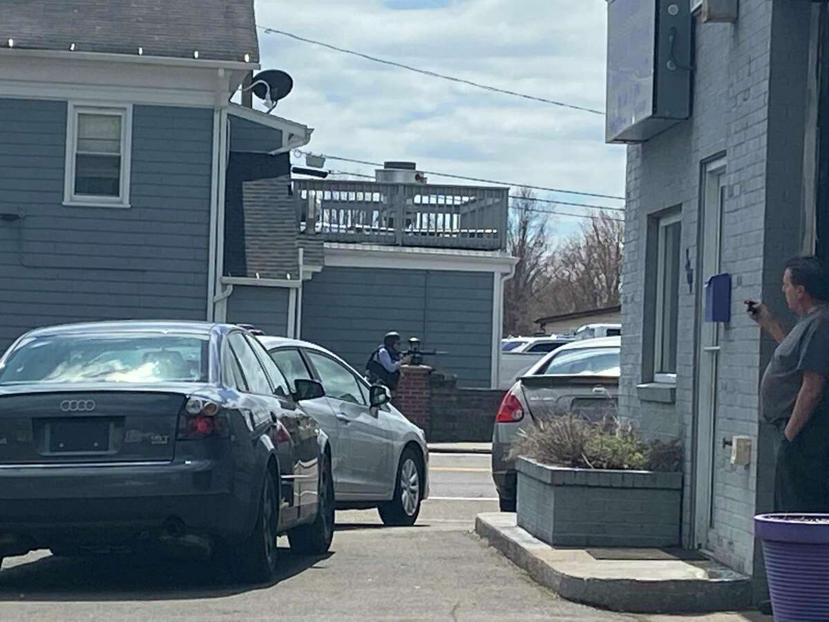 Police personnel seen near Tuesday's shooting incident in Branford.
