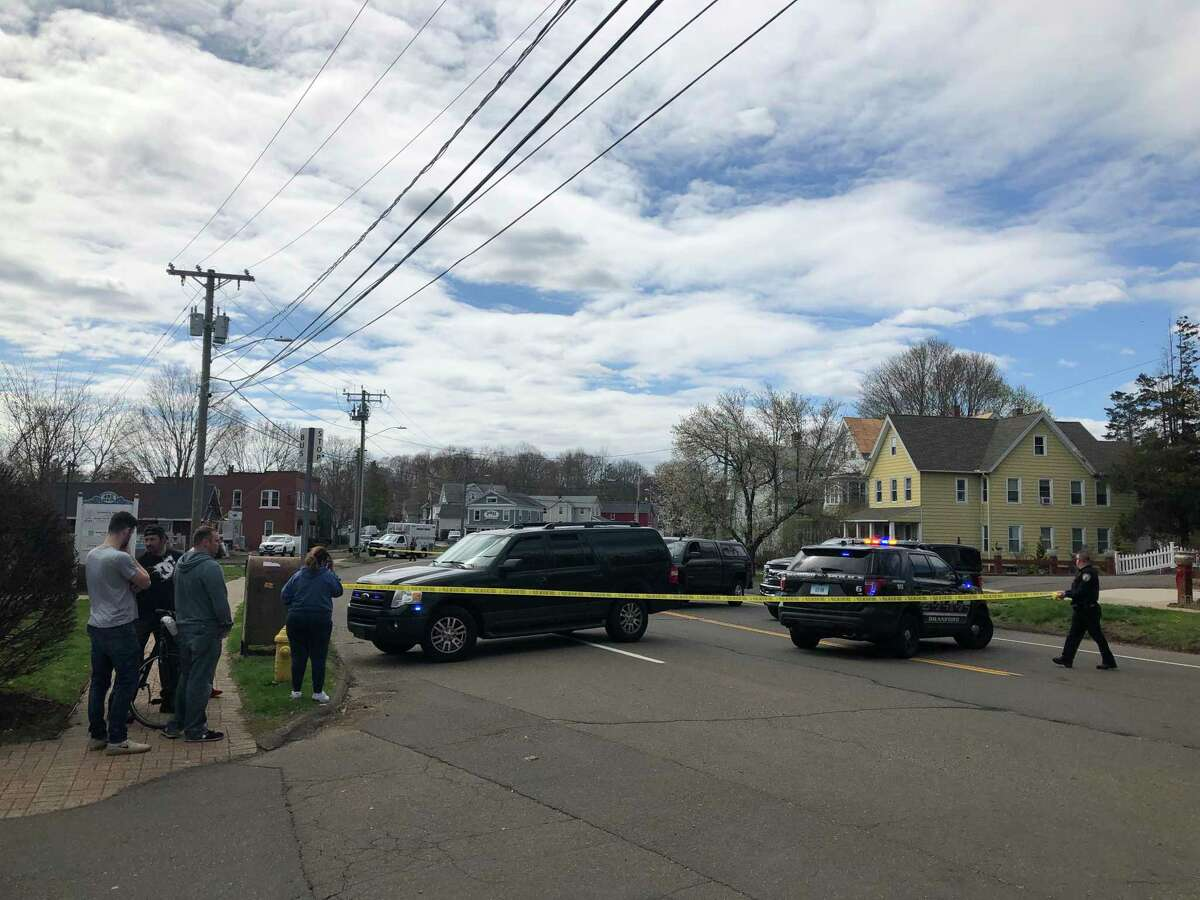 Police putting up tape near the intersection of Main and Russell streets in Branford Tuesday.