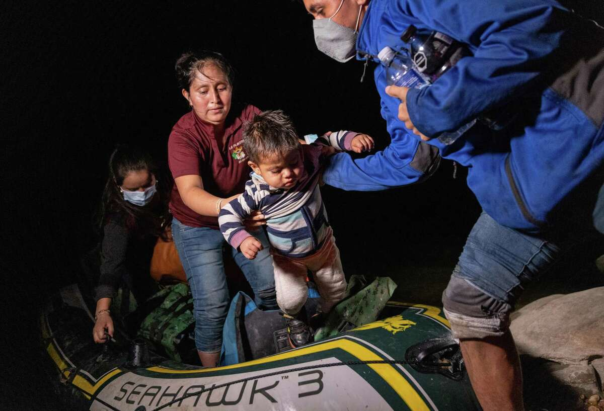ROMA, TEXAS - APRIL 11: Guatemalan immigrant Andy, 3, is lifted from a raft into the United States after he and his family were smuggled across the Rio Grande from Mexico on April 11, 2021 in Roma, Texas. A surge of immigrants crossing into the United States, including record numbers of children, has challenged U.S. immigration agencies along the southern border. (Photo by John Moore/Getty Images)