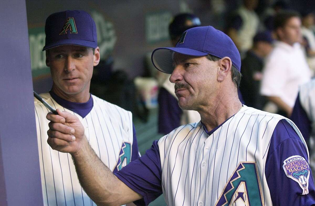 Diamondbacks manager Bob Brenly looks over the lineup with coach Bob Melvin in a game against the cardinals at Bank One Ballpark. Photo by Michael Chow/The Arizona Republic 4/17/02
