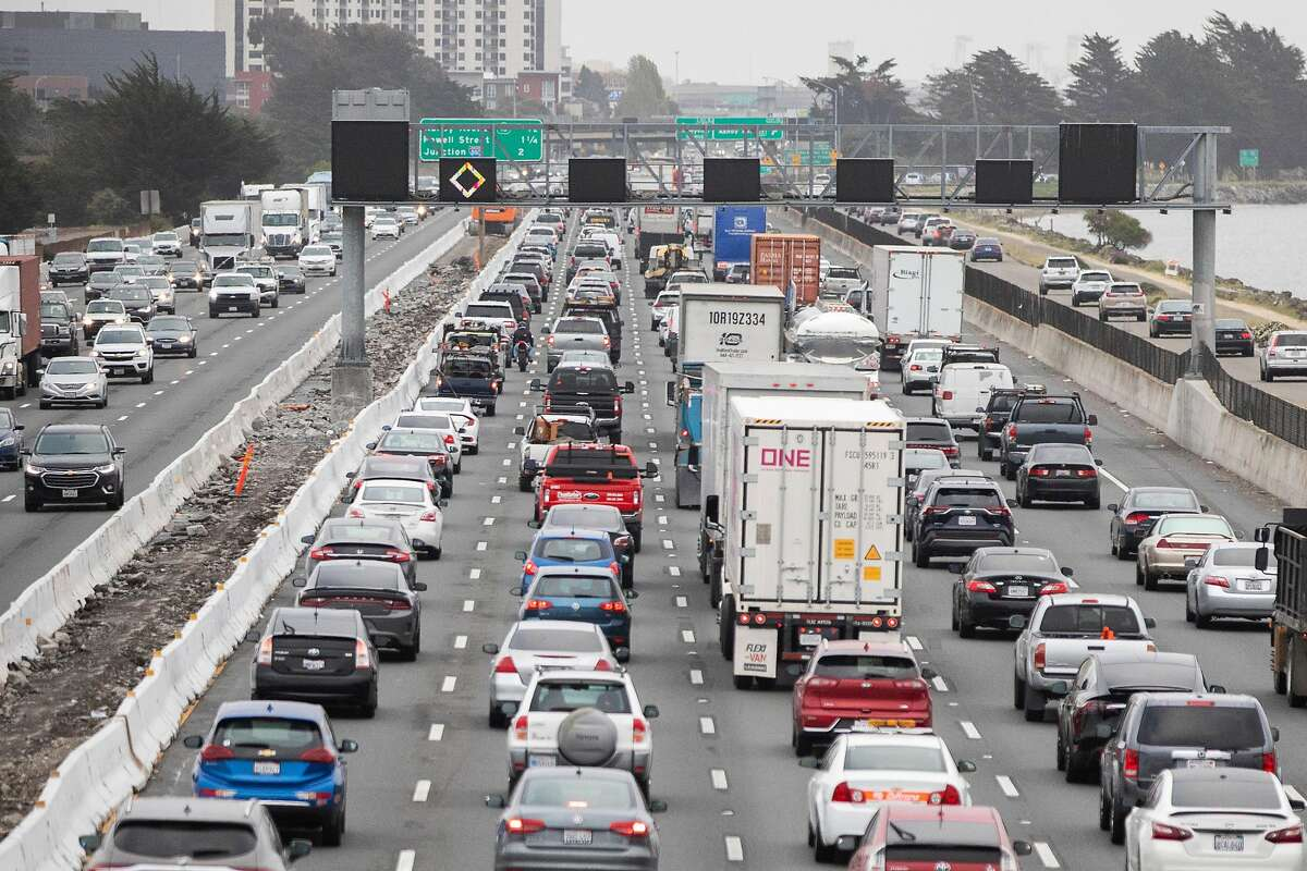 Morning commuter traffic backs up on Interstate 80 westbound in Berkeley, Calif. Tuesday, April 6, 2021. A third of Bay Area residents plan to commute less after the pandemic, but most of the drop in demand will be non-car transit.