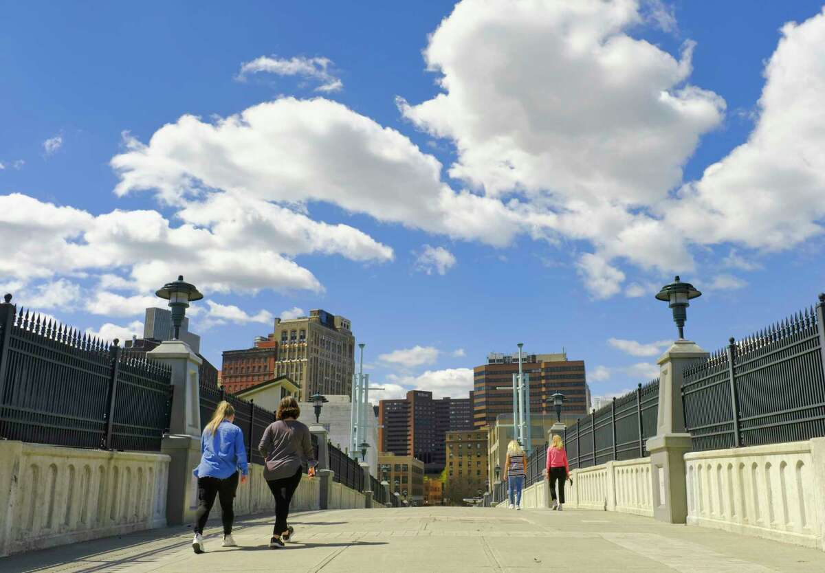 People make their over the Hudson River Way pedestrian bridge, heading back into downtown, on Tuesday, April 13, 2021, in Albany, N.Y. (Paul Buckowski/Times Union)