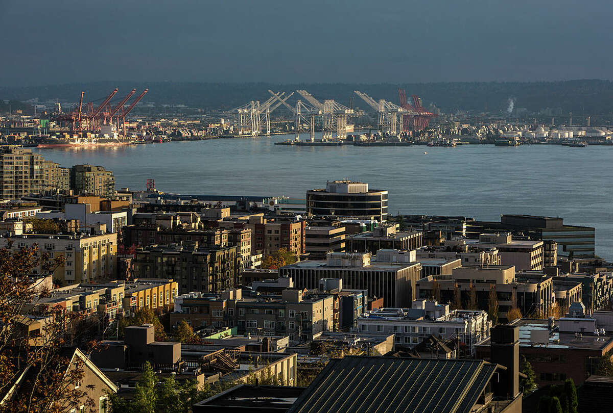 The sun sets on the Port of Seattle and downtown waterfront as viewed from Queen Anne Hill on November 4, 2015, in Seattle, Washington, located in King County.