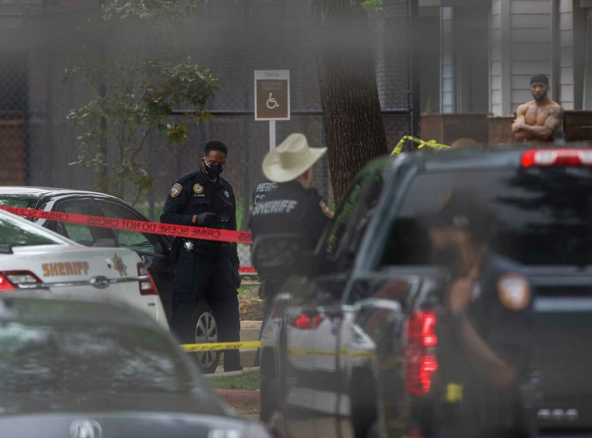 Harris County Sheriff's Office authorities investigate a homicide scene where a man was found dead with at least one gunshot wound at an apartment complex on 19600 block of Park Row Tuesday, April 13, 2021, in Houston. The victim was identified as an adult Black male.