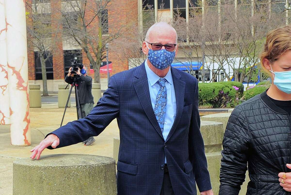 Former Bridgeport Personnel Director David Dunn leaves the United States Court House Federal Building in downtown Bridgeport, Conn., on Tuesday April 13, 2021. Dunn was at the courthouse to be sentenced for his involvement in the police chief cheating scandal.