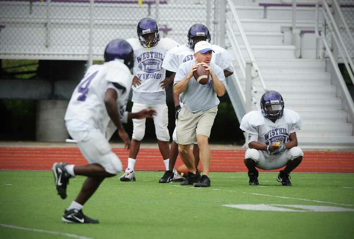 Westhill High School football coach Dick Cerone works the team through practice at Westhill in Stamford, Conn. on Friday September 10, 2010.