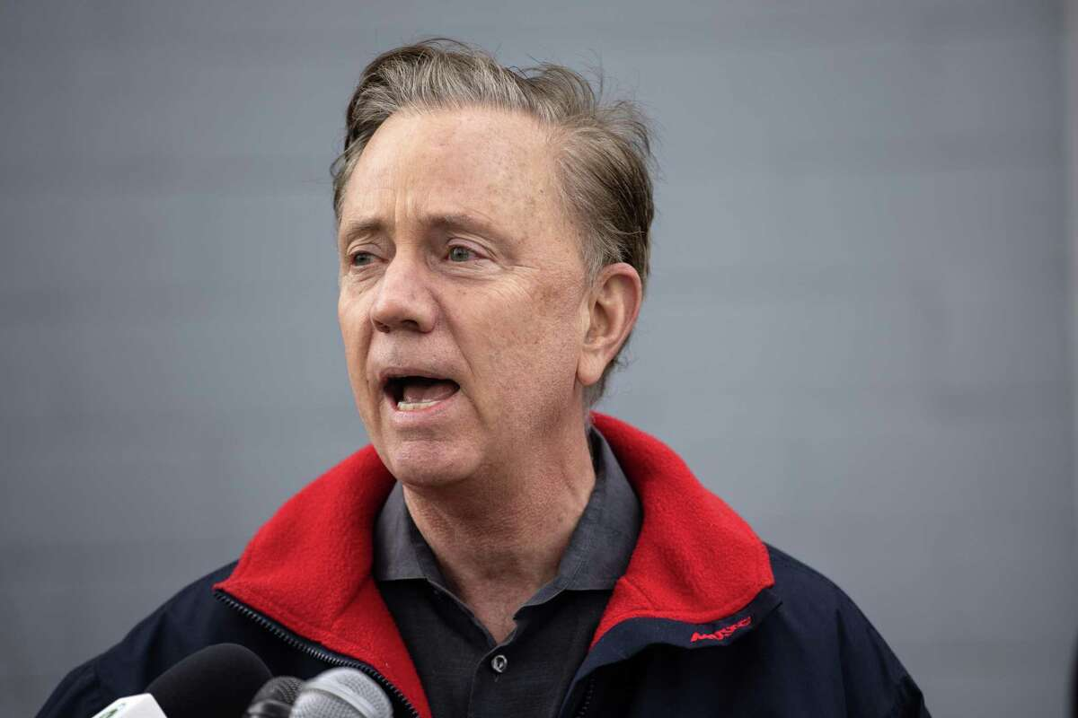 Gov. Ned Lamont speaks at a COVID-19 community vaccination clinic March 14 in Stamford. Health workers administered the first dose of the Moderna vaccine to more than 350 people from the immigrant and undocumented communities.