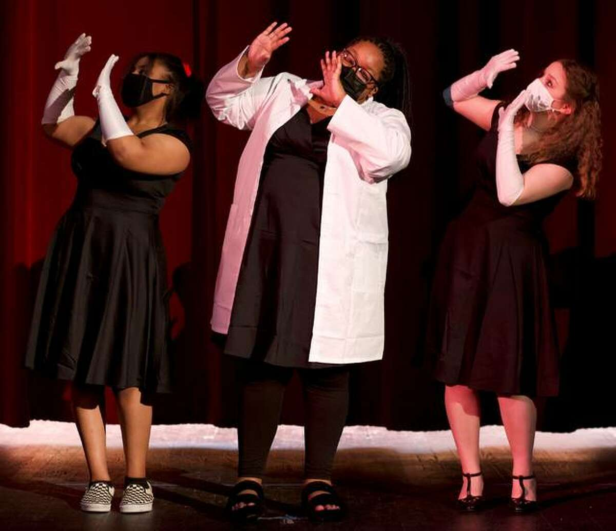 """Moving """"Little Shop of Horrors"""" along is the chorus of E'Niya Fields, Morgan Palmer and Corrine Jones. Alton High School's production of """"Little Shop of Horrors is set April 22-25."""