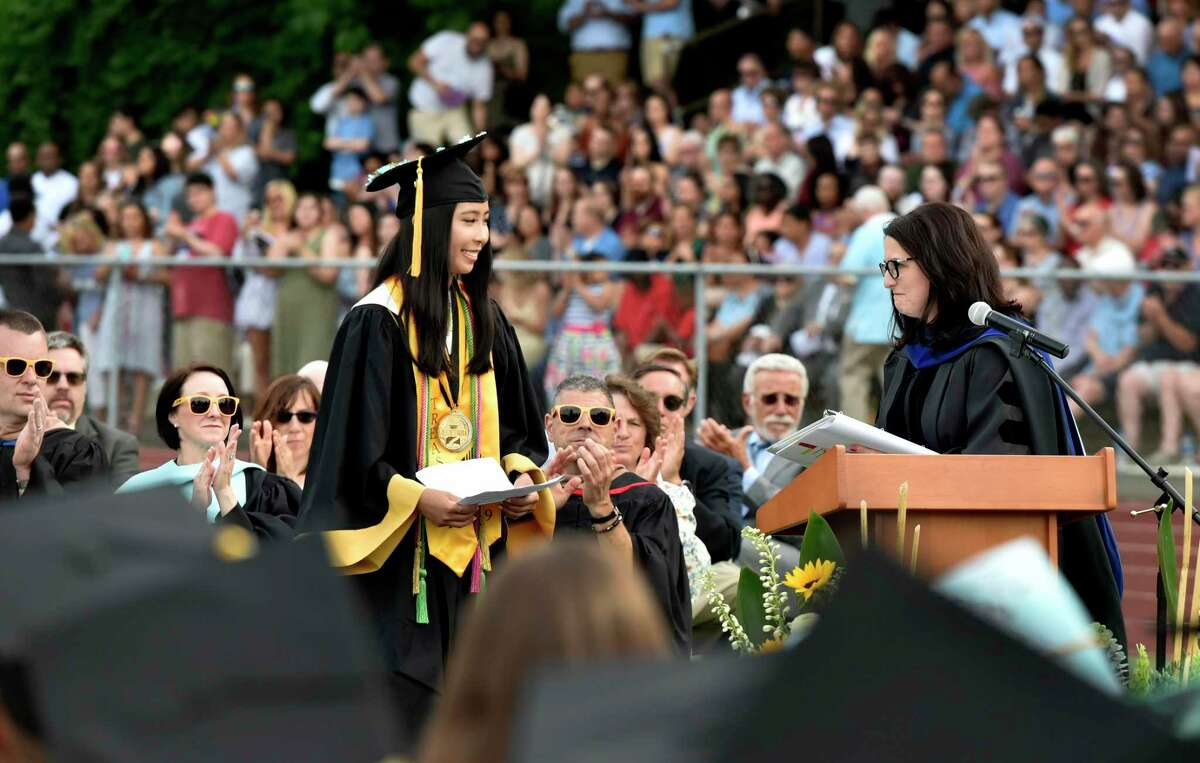 Jonathan Law H.S. Valedictorian Ming-May Hu, left, is introduced by Superintendent of Schools Dr.Anna Cutaia during Jonathan Law High School's 2019 graduation.