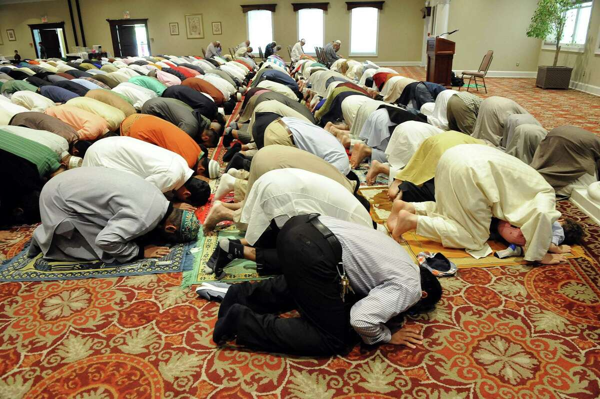 The Muslim community in greater Danbury joined together for an Eid prayer service to celebrate the end of Ramadan, Wednesday, July 6, 2016, held at the Amber Room in Danbury.