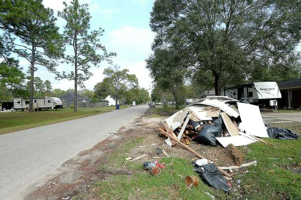 While the post-Harvey clean-up piles have diminished in number and scope, often they have been replaced simply by smaller piles, broken bits of debris, and the ashy remains of gutted interiors. In hard hit regions, like Rose Hill Acres, subdivisions bear the lingering smell of mold as residents continue the process of rebuilding, many taking temporary shelter in campers parked outside their homes. Photo taken Thursday, November 2, 2017 Kim Brent/The Enterprise
