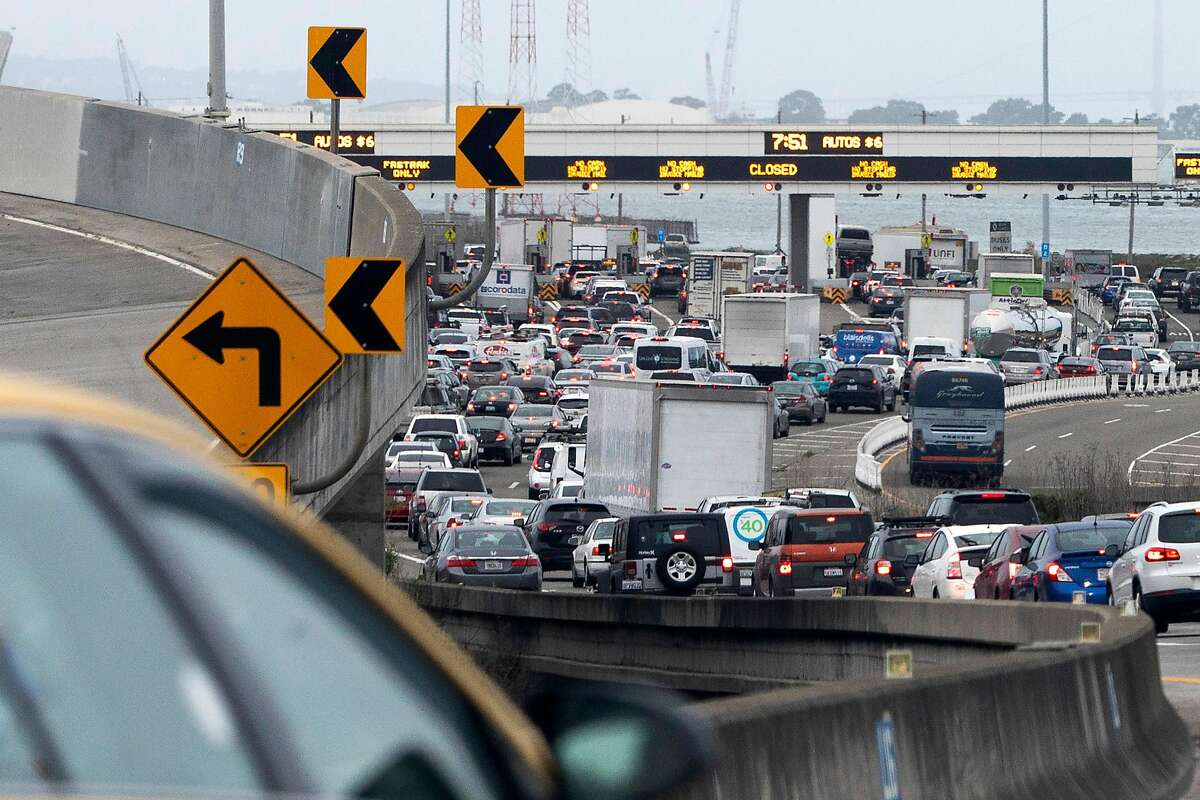 Traffic backs up at the toll plaza along I-80 westbound in Emeryville during the morning commute last week.