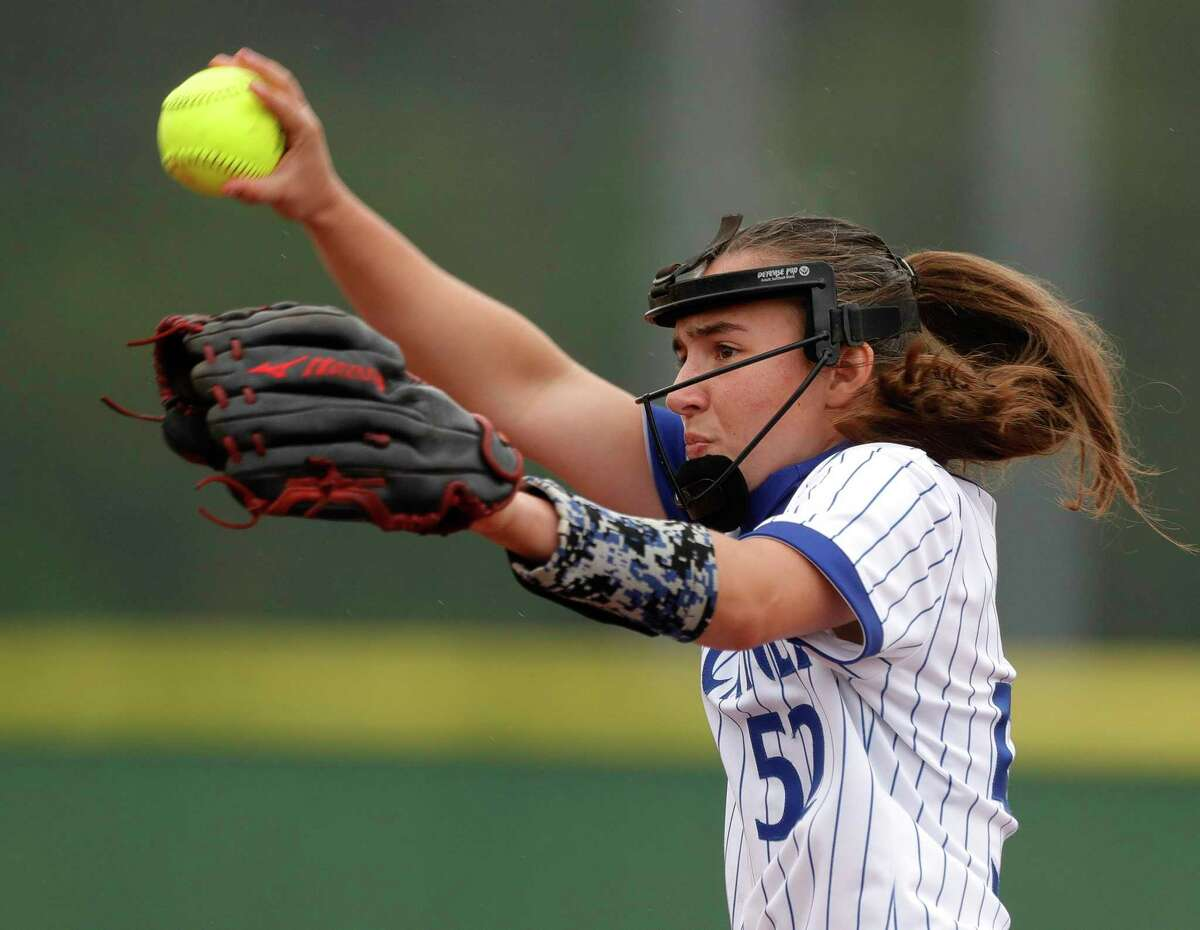 New Caney starting pitcher Savannah Youngblood (52) throws during the first inning of a District 20-5A high school softball game, Tuesday, April 13, 2021, in New Caney.