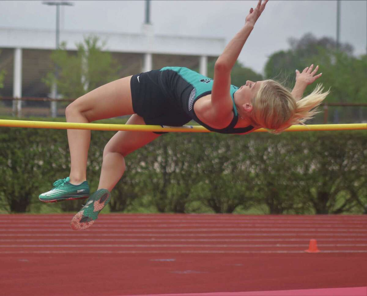 Pasadena Memorial's Paige Harbuck attempts to clear the high jump bar during the 22-6A action on March 31. She'll return for the Area competition on Wednesday afternoon.