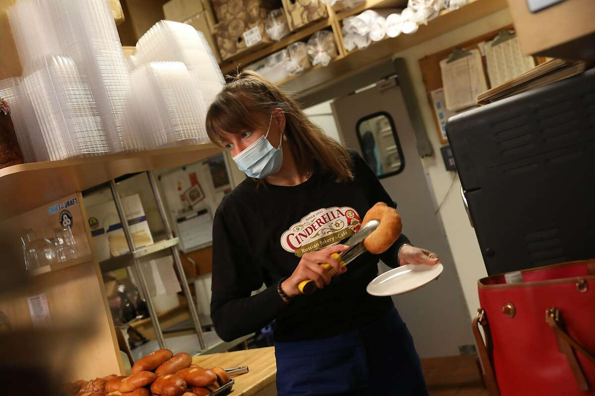 Cinderella Bakery employee Anya Baskakova prepares a piroshki for a customer in the Inner Richmond.
