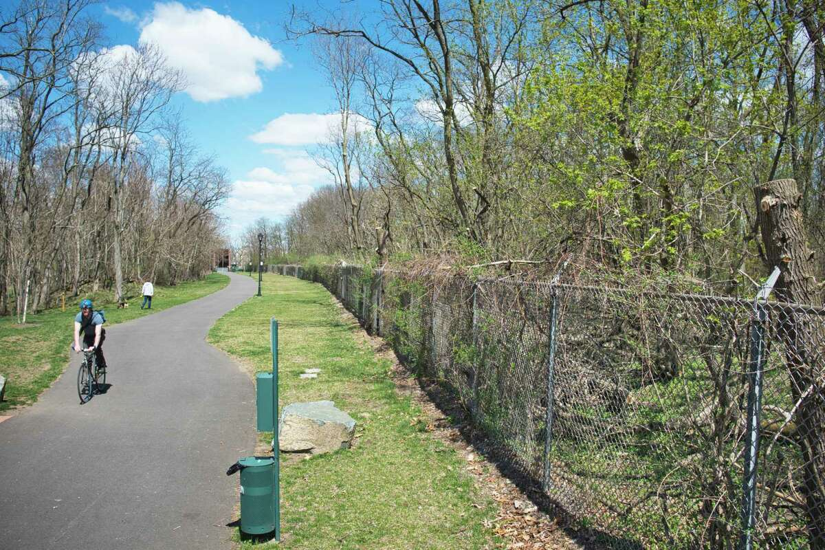 A view of the fenced in area, on right, that is the former Ford Motor Company property, seen here next to the bike path at the end of Cannon St. in Green Island, N.Y. Photo taken on Tuesday, April 13, 2021. The Green Island Industrial Development Agency wants to develop 30 acres of this land. (Paul Buckowski/Times Union)