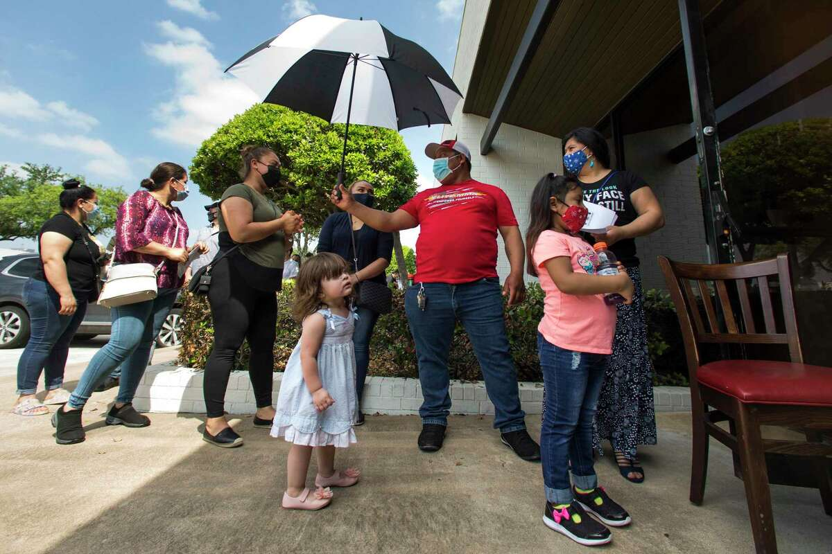 Employees of Legacy Restaurants group line up to receive the Pfizer BioNTech vaccine during a COVID-19 vaccine clinic Monday, April 12, 2021 in Houston. Legacy Restaurants, parent company of The Original Ninfa's and Antone's Famous Po' Boy, vaccinated hundreds of employees and their spouses in the last week as part of a push to restore normalcy inside Houston's restaurants.