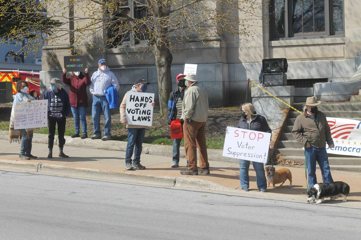 Over two dozen people attended a rally at Manistee City Hall on Tuesday in support of voting rights.