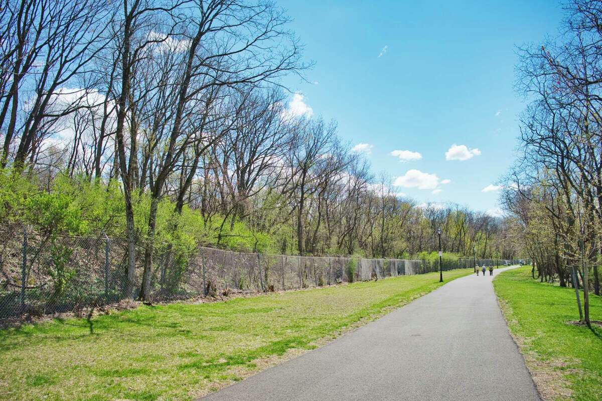 A view of the fenced in area, on left, that is the former Ford Motor Company property, seen here next to the bike path at the end of Cannon St. in Green Island, N.Y. Photo taken on Tuesday, April 13, 2021. The Green Island Industrial Development Agency wants to develop 30 acres of this land. (Paul Buckowski/Times Union)