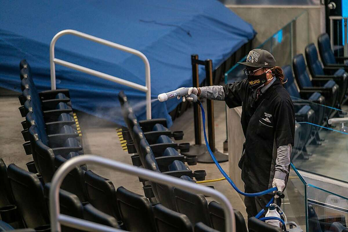 Ryan Tirazona, demonstrates a mobile sanitizing device used to clean seats at The Chase Center in San Francisco on Tuesday, April 13, 2020. The Warriors plan to welcome fans back to the Chase Center for games beginning on April 23rd.