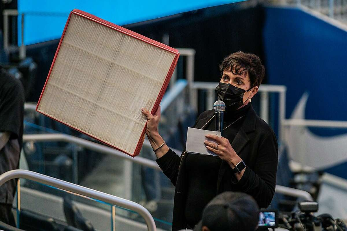 Kim Stone, The Chase Center General Manager, holds up the improved air filter that is being used throughout the arena in San Francisco on Tuesday, April 13, 2020. The Warriors plan to welcome fans back to the Chase Center for games beginning on April 23rd.