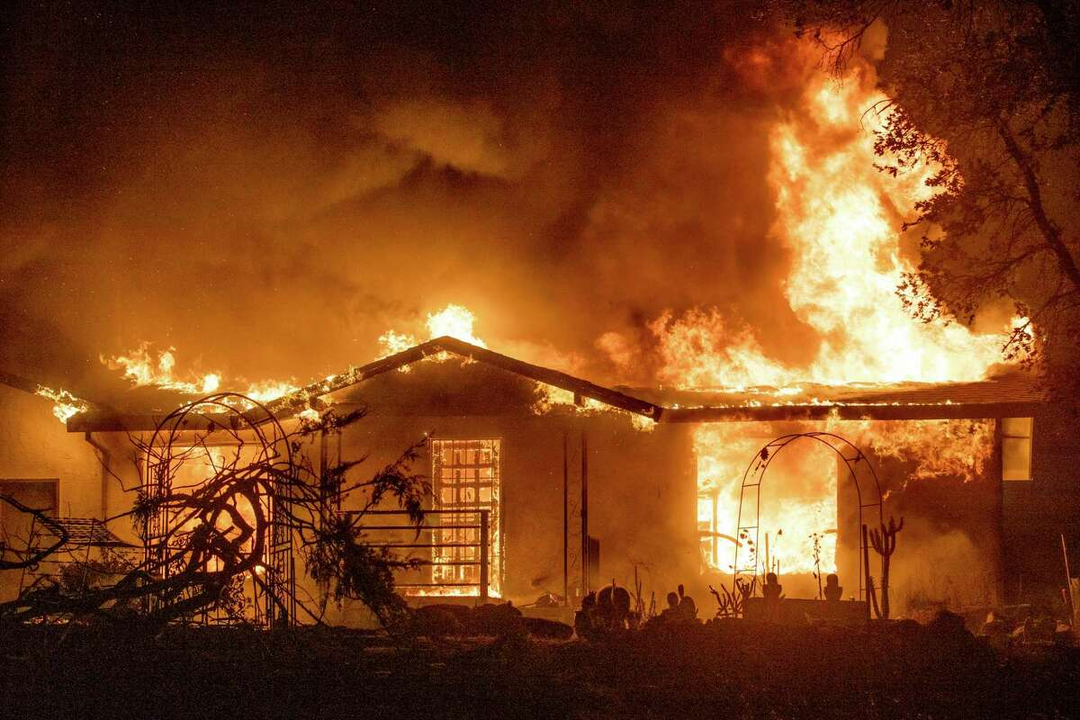 A house burns in the Zogg Fire near Ono on Sept. 27,the day the fire started.