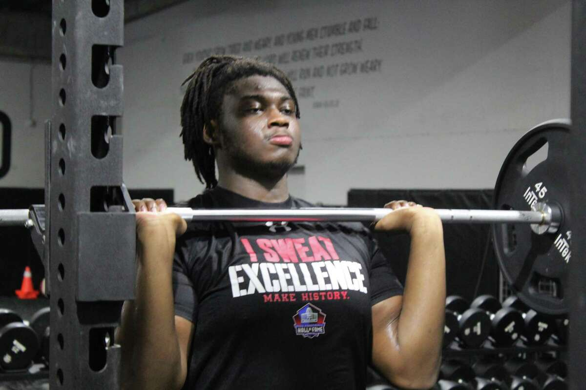 Texas A&M's Kenyon Green, working out last summer at Atascocita, is looking forward to move to left tackle for Aggies.