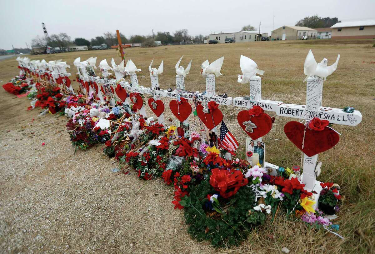 Twenty-six crosses are placed near the street at the First Baptist Church, Sunday, Dec. 17, 2017, in Sutherland Springs. A gunman killed 26 people in the church on November 5. ( Karen Warren / Houston Chronicle )