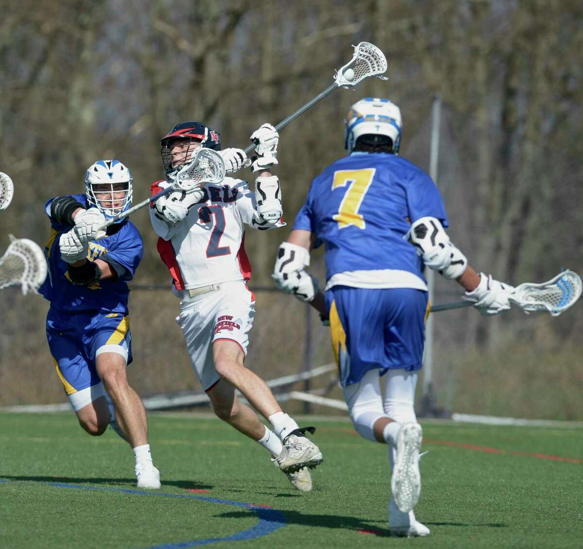 New Fairfield's Nathan Alviti (2) shoots while being defended by Brookfield's Ryan Sanborn (19) in the boys lacrosse game between Brookfield and New Fairfield high schools. Tuesday, April 13, 2021, at New Fairfield High School, New Fairfield, Conn.