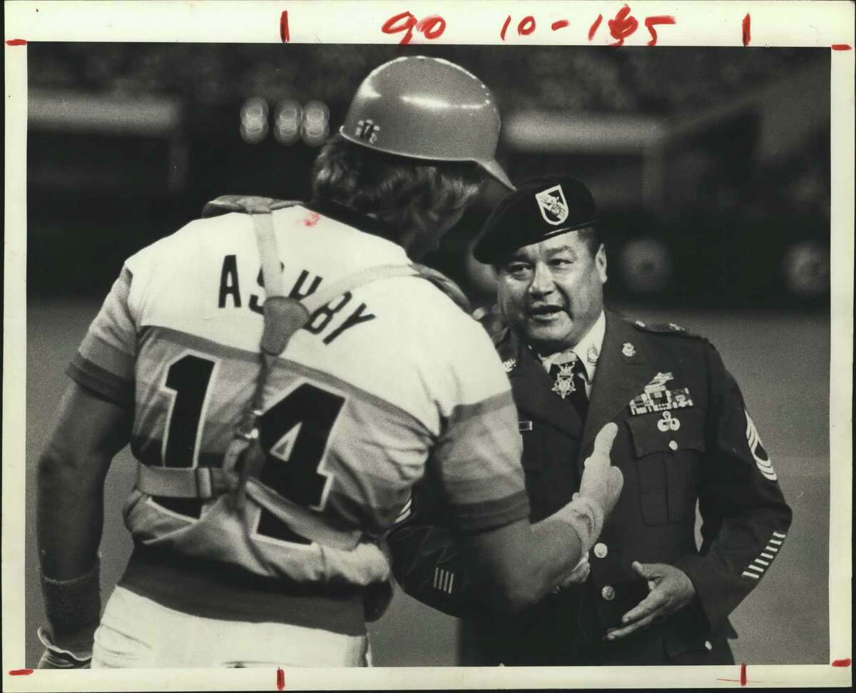 At right, catcher Alan Ashby greets Sgt. Roy Benavidez, a recent Medal of Honor recipient who tossed out the ceremonial first pitch at a Houston Astros game in 1981.