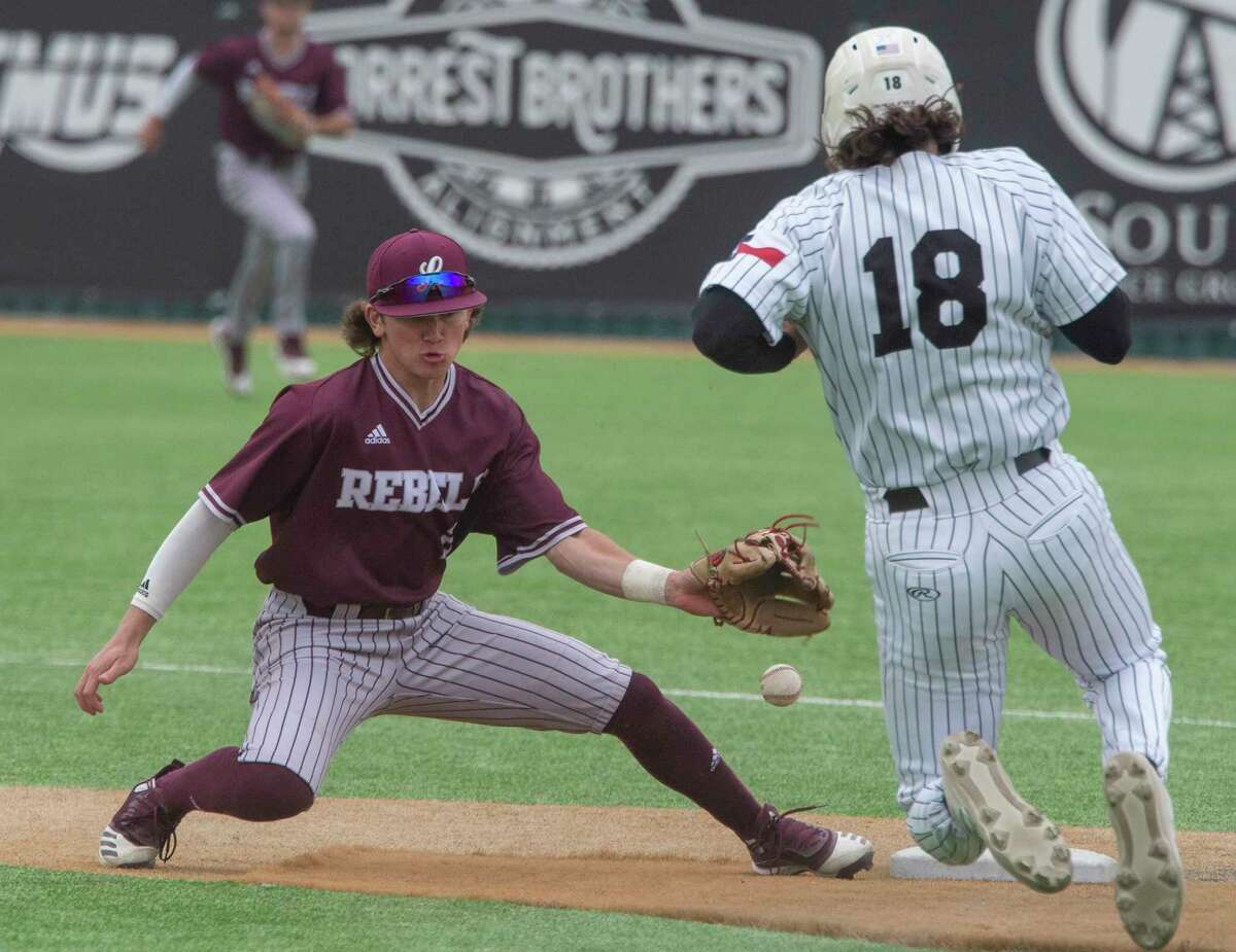 Lee High's Brayden Wynne can't handle the throw at second as Permian's Cooper Golden safely makes it back to the bag 04/13/21 at McCanlies Field in Odessa. Tim Fischer/Reporter-Telegram
