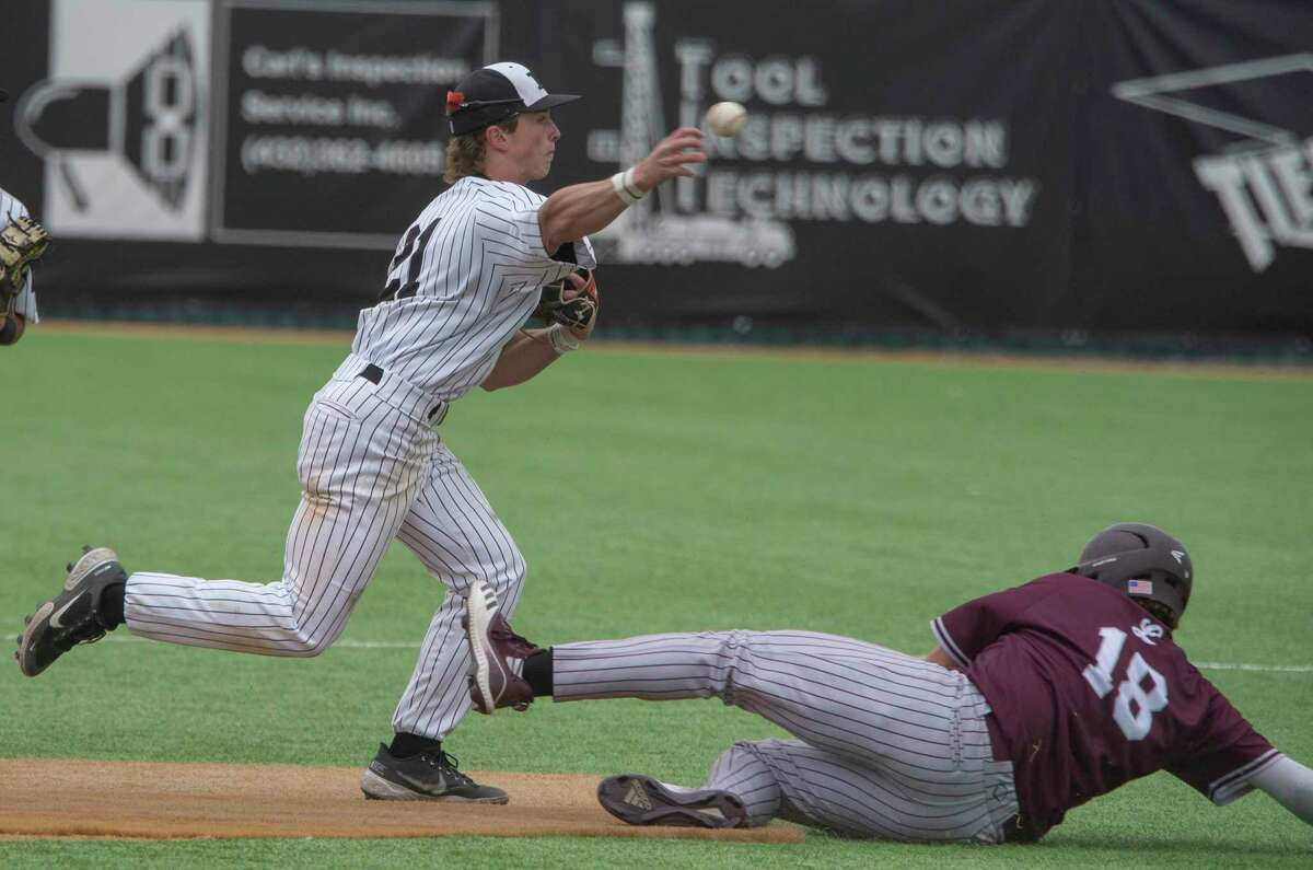 Permian's Jake Glasman can't make the double play throw in time after getting the force out at second on Lee High's Casen Yonts 04/13/21 at McCanlies Field in Odessa. Tim Fischer/Reporter-Telegram