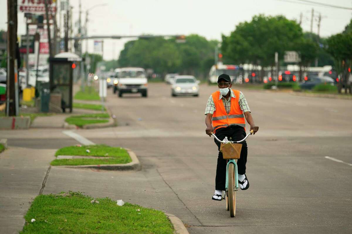 A cyclist pedals up Hillcroft Avenue north of Bellaire Boulevard on Tuesday, April 13, 2021, in Houston. The city is set to begin work on Hillcroft that would take the eight-lane street down to six lanes, adding new bike lines and attempting to make the stretch of road more pedestrian friendly.