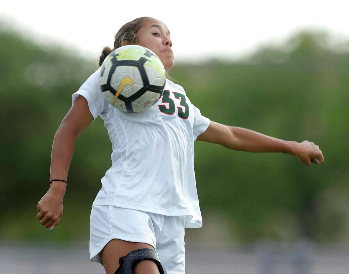 The Woodlands midfielder Kennedy Floyd (33) looks to control the ball during the first period of a Class 6A girls UIL state semifinal match at Belton High School, Tuesday, April 13, 2021, in Belton.