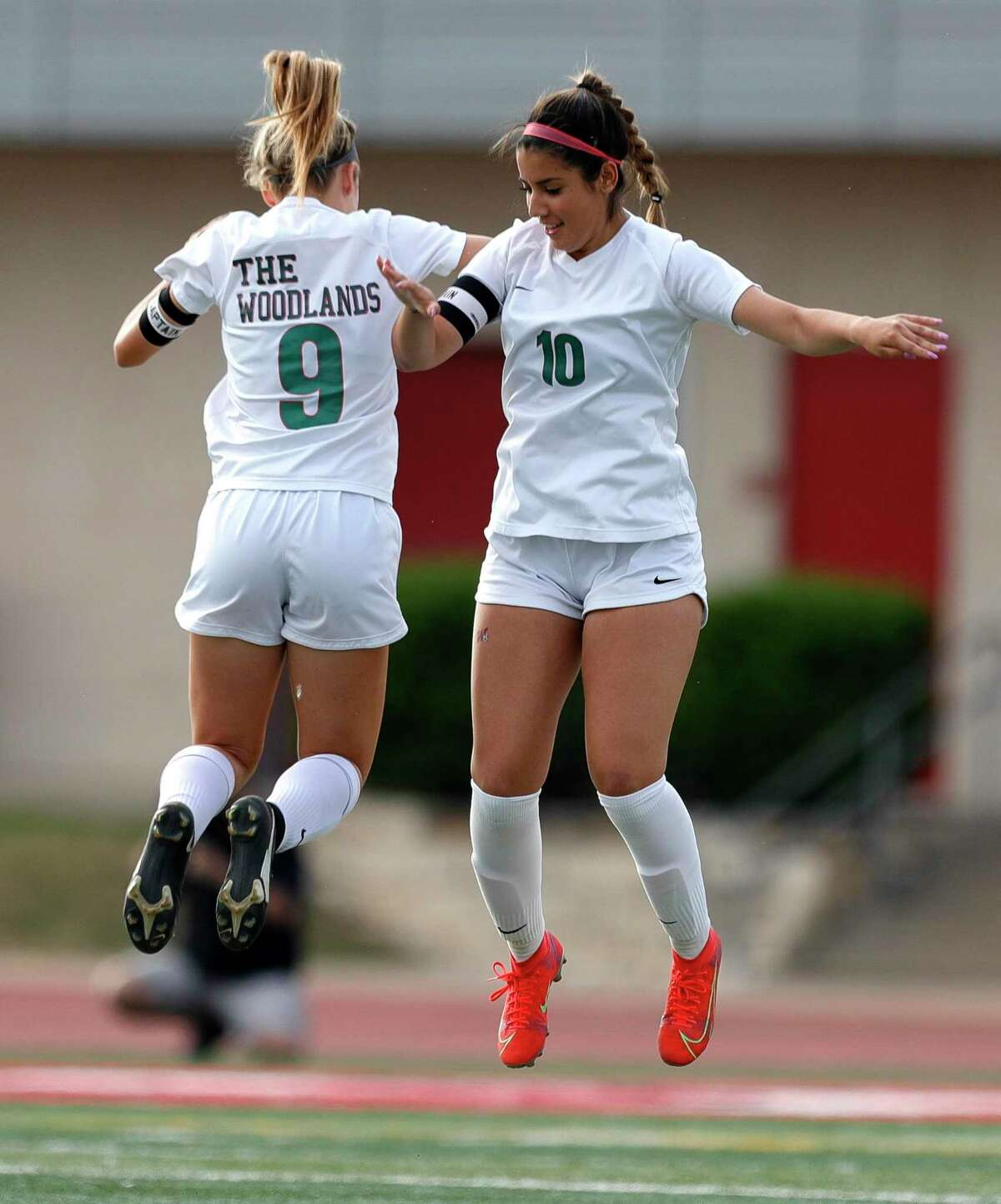 The Woodlands midfielder Ivana Palomo (10) gets defender Emily Bates (9) pumped before the start of the first period of a Class 6A girls UIL state semifinal match at Belton High School, Tuesday, April 13, 2021, in Belton.