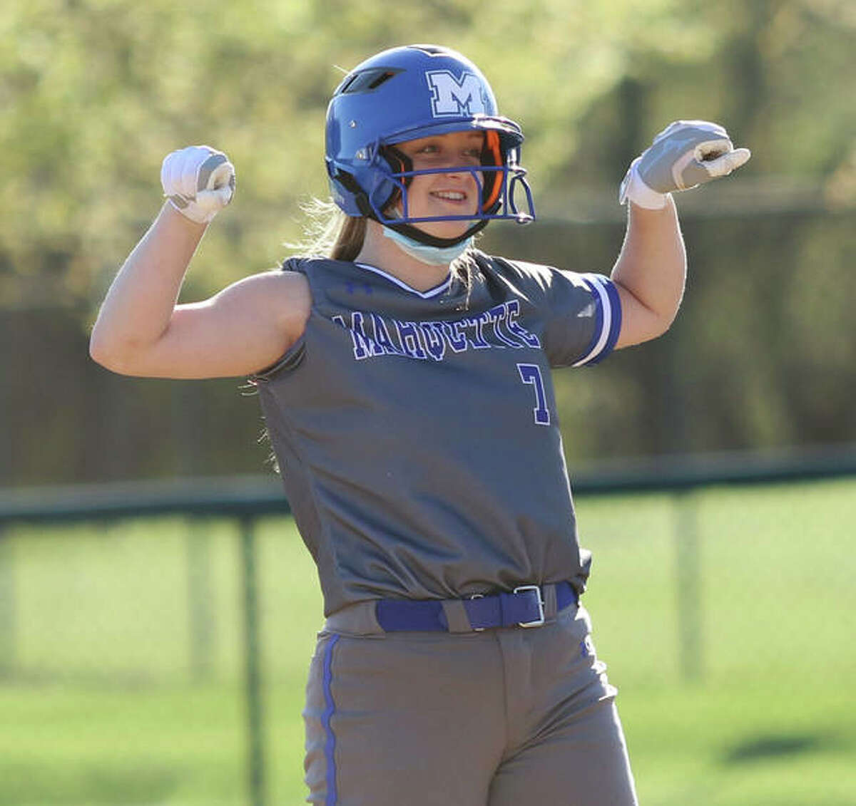 Marquette's KB Kirchner acknowledges cheers from the Explorers dugout after her two-run double in the fourth inning Monday at Moore Park in Alton.