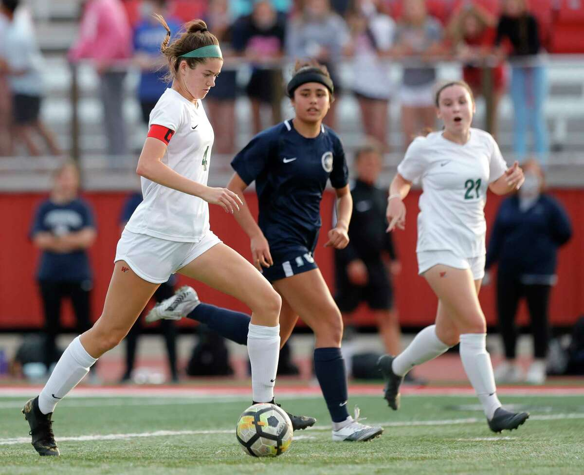The Woodlands defender Marley Krach (4) dribbles the ball during the second period of a Class 6A girls UIL state semifinal match at Belton High School, Tuesday, April 13, 2021, in Belton.