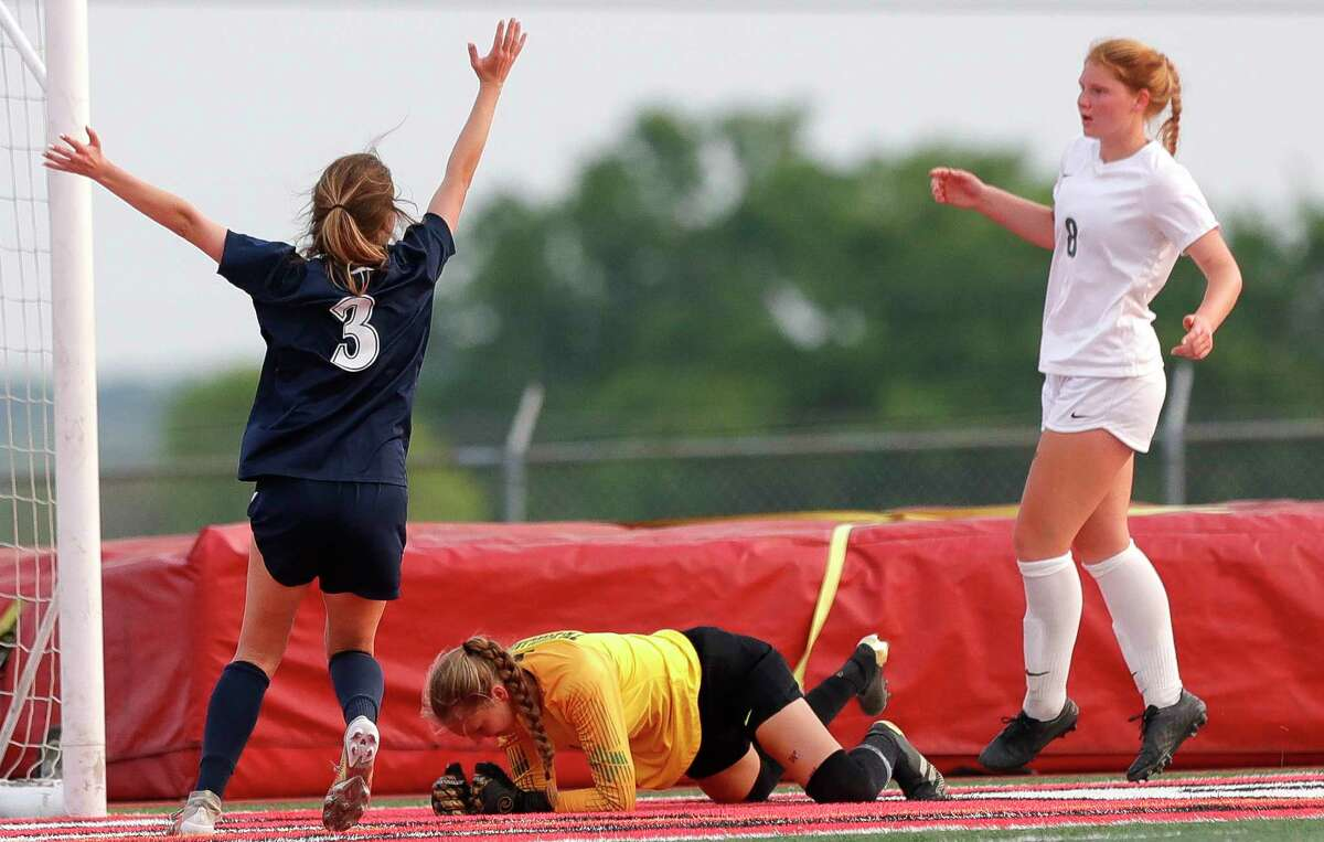 The Woodlands goalie Isabella Hollenbach (1) pounds the ground after Flower Mound forward Tatum Beck (3) scored a goal during the second period of a Class 6A girls UIL state semifinal match at Belton High School, Tuesday, April 13, 2021, in Belton.