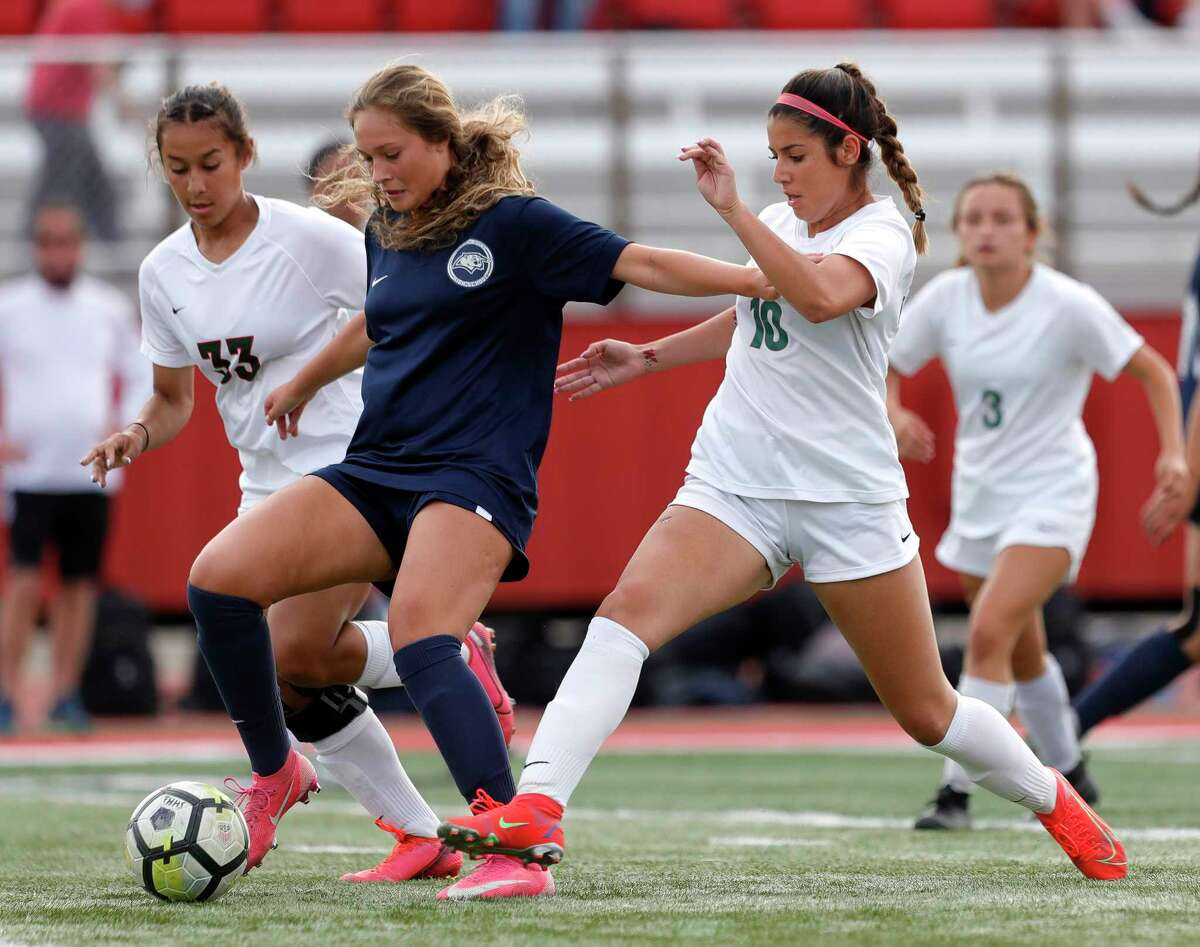 Flower Mound midfielder Katherine Tokar (center) battles The Woodlands' Ivana Palomo (10) and Kennedy Floyd (33) for the ball during the first period of a Class 6A girls UIL state semifinal match at Belton High School, Tuesday, April 13, 2021, in Belton.