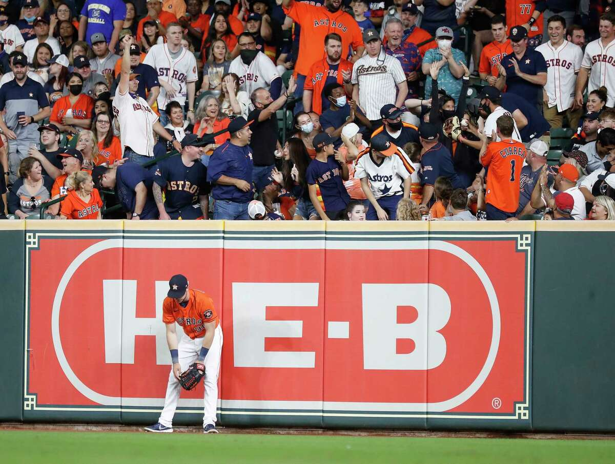 Houston Astros right fielder Kyle Tucker (30) slumps against the wall after he tried to chase Detroit Tigers Wilson Ramos' second home run of the night into the right field stands during the fifth inning of an MLB baseball game at Minute Maid Park, in Houston, Tuesday, April 13, 2021.