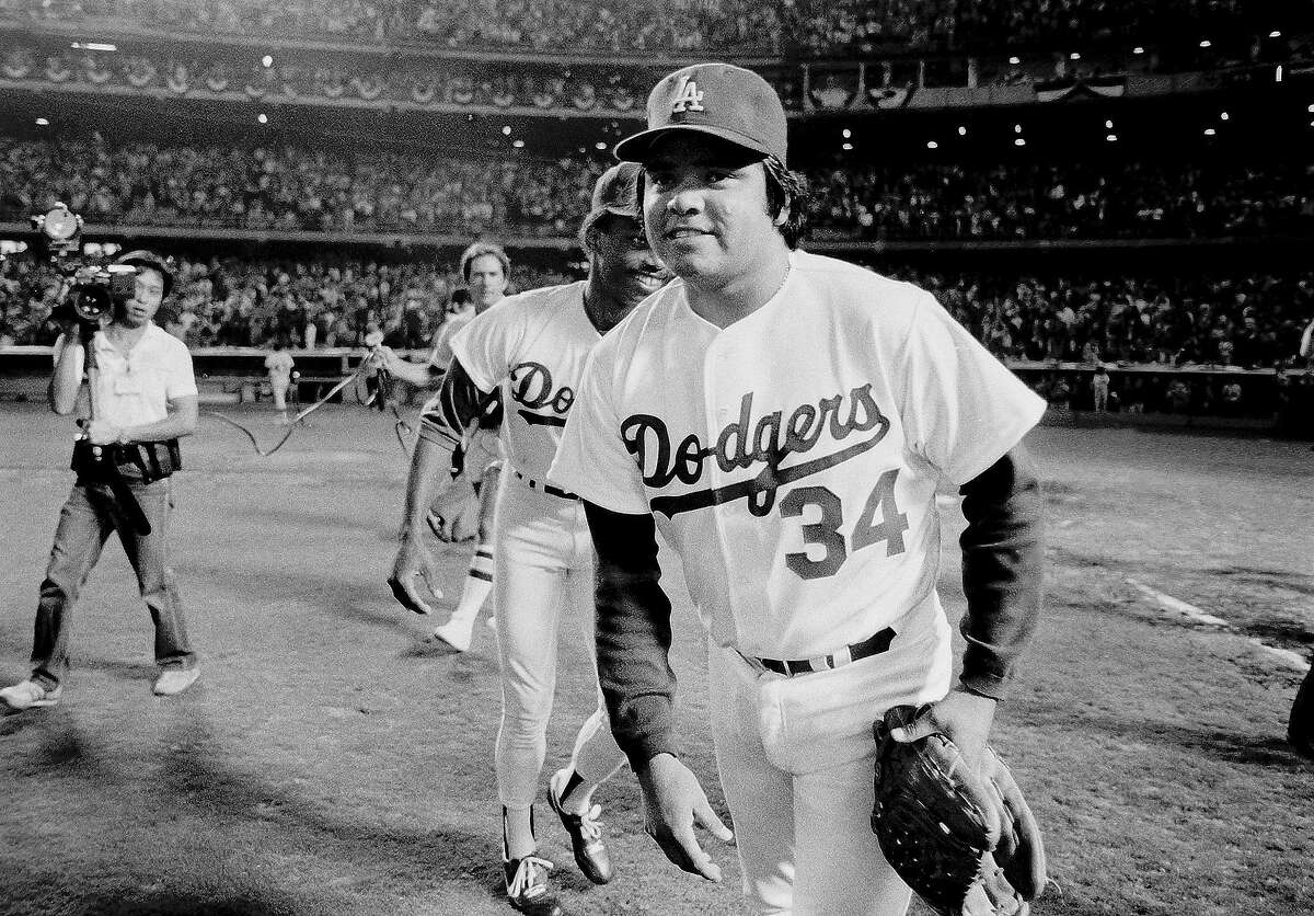 LOS ANGELES, CA - OCTOBER 10, 1981: Fernando Valenzuela #34 of the Los Angeles Dodgers walks off the field after defeating the Houston Astros during the 1981 National League Division Series at Dodger Stadium, Los Angeles, California. (Photo by Jayne Kamin-Oncea/Getty Images)