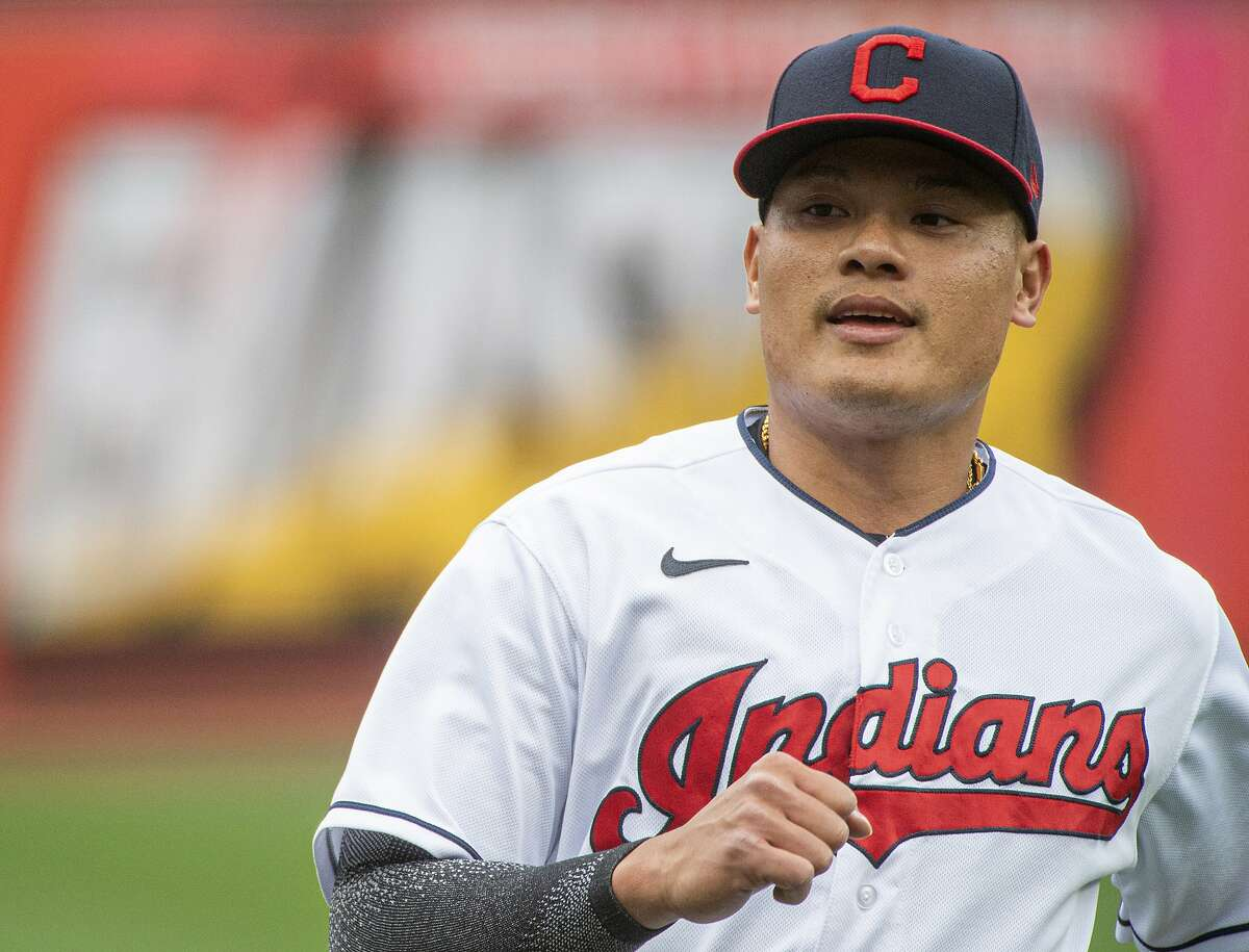 Cleveland Indians' Yu Chang warms up before a baseball game against the Detroit Tigers in Cleveland, Saturday, April 10, 2021. (AP Photo/Phil Long)