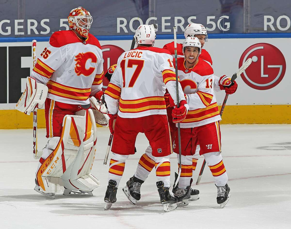 TORONTO, ON - APRIL 13: Johnny Gaudreau #13 of the Calgary Flames celebrates his overtime winning goal against the Toronto Maple Leafs during an NHL game at Scotiabank Arena on April 13, 2021 in Toronto, Ontario, Canada. The Flames defeated the Maple Leafs 3-2 in overtime. (Photo by Claus Andersen/Getty Images)