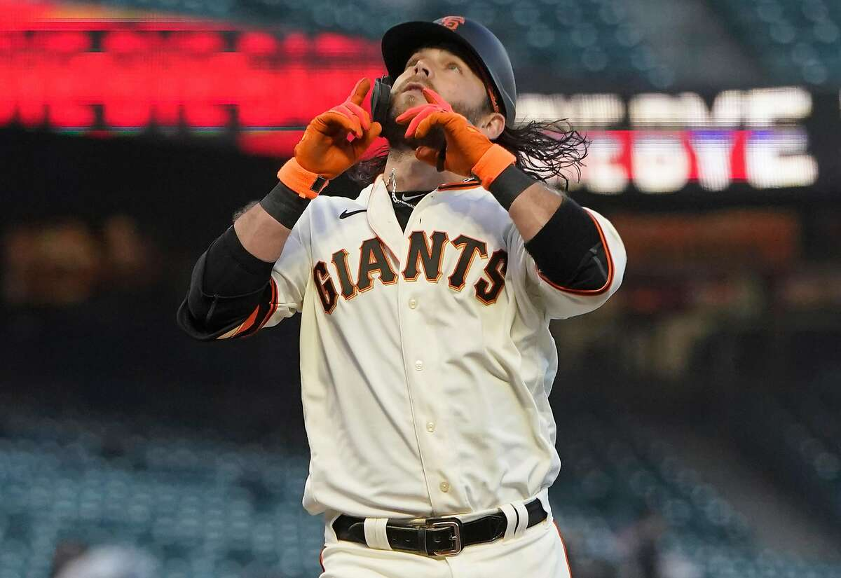 SAN FRANCISCO, CALIFORNIA - APRIL 13: Brandon Crawford #35 of the San Francisco Giants celebrates after his two-run home run against the Cincinnati Reds in the first inning at Oracle Park on April 13, 2021 in San Francisco, California. (Photo by Thearon W. Henderson/Getty Images)