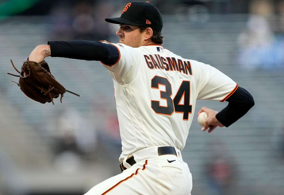 SAN FRANCISCO, CALIFORNIA - APRIL 13: Kevin Gausman #34 of the San Francisco Giants pitches against the Cincinnati Reds in the first inning at Oracle Park on April 13, 2021 in San Francisco, California. (Photo by Thearon W. Henderson/Getty Images)