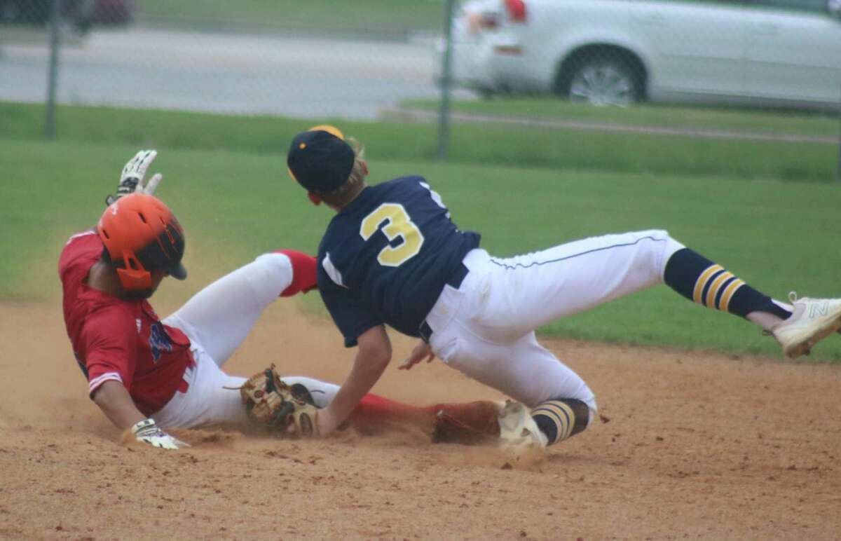 FBCA's Matthew Cundiff takes second base against the defense of Luke Dalke and Logos Prep Tuesday at Warriors Field. Cundiff had the only hit in the seventh inning until Ryan Towe's walkoff shot.