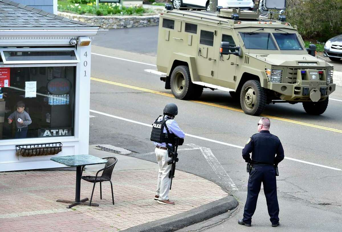 A New Haven Police Emergency Services unit drives near an active shooter scene on Main Street in Branford Tuesday afternoon.